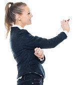 Caucasian female teacher standing wearing pants and using pen