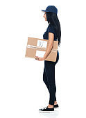 Latin american and hispanic ethnicity female delivery person standing in front of white background wearing jeans