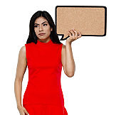Latin american and hispanic ethnicity young women standing in front of white background wearing dress and holding questionnaire