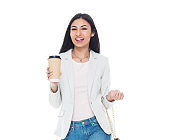 Latin american and hispanic ethnicity young women wearing blazer and holding coffee cup