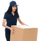 Latin american and hispanic ethnicity female manual worker standing in front of white background wearing cap - hat and holding package