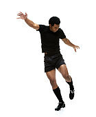 Pacific islander ethnicity teenage boys athlete chasing in front of white background wearing shorts