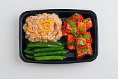 Pre-made meals and Takeout food served in to-go boxes. Organic healthy food, fresh fruits and steamed vegetables. Classic America lunch or dinner meal.