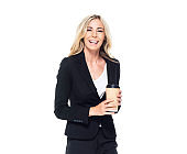 Caucasian female businesswoman standing and holding coffee cup
