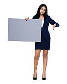 Latin american and hispanic ethnicity young women business person standing wearing blazer and holding banner sign