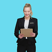 Caucasian young women business person standing in front of blue background wearing businesswear and holding contract