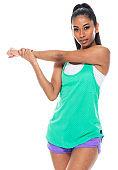 Latin american and hispanic ethnicity female sleeveless exercising in front of white background wearing shorts
