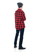 Caucasian young male hipster standing in front of white background wearing boot