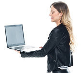 Side view / profile view / one person / waist up / portrait of 20-29 years old adult beautiful blond hair / long hair caucasian / generation z female / young women standing wearing leather jacket / pants / t-shirt / shirt who is working