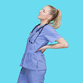 Caucasian female standing in front of blue background