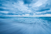 A beautiful moody blue seascape taken on an overcast day with dramatic stormy clouds