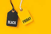 Sale tags with Black Friday written on yellow background
