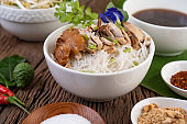 Chicken noodle in a bowl with side dishes, Thai food. Selective focus