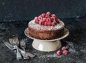 Delicious chocolate fresh raspberry sponge cake on dark background. Tasty dessert