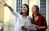 Young tourists enjoying on vacation, having fun together in the city. Concept of tourism