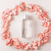 Bottle of perfume framed from rose petals.
