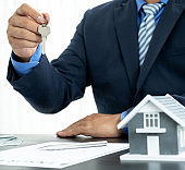 Hand a real estate agent, hold the keys, and explain the business contract, rent, buy, mortgage, loan, or home insurance