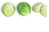 Brussels sprouts and half isolated on white background with clipping path and full depth of field. Top view with copy space for your text. Flat lay