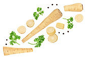 Parsnip root and slices with parsley peppercorns isolated on white background with clipping path. Top view. Flat lay