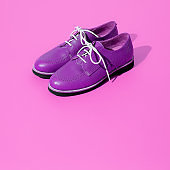 Vintage stylish shoes in isometric on purple background. Minimal fashion retro concept. Still life