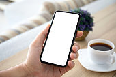 male hands holding phone with isolated screen in room