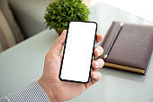 male hands holding phone with isolated screen in office