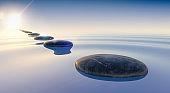 3d render of black stones on calm sea water