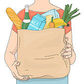 Person carrying a paper bag of ripe vegetables from a farm with an advertisement on it.