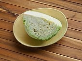 Wooden boards background and fresh organic vegetable cabbage