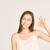 Young beauty girl sign ok. Zero gesture woman smile portrait. Female people hand show approve symbol. Copyspace