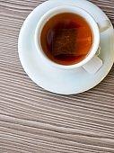 Tea on wooden boards and porcelain cups, black tea