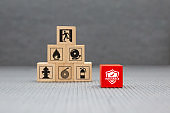 Wooden toy blocks with protect icon for fire safety protection and insurance concepts.