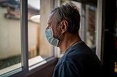 Senior man in home quarantine