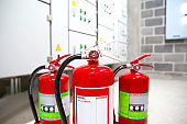 Red fire extinguishers in the fire control room for safety prevention and fire training.