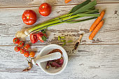 Ingredients for ketchup on a textural background in vintage style.