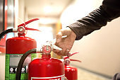 Engineer are inspection Fire extinguisher in fire control room for prevention emergency, rescue and safety or fire extinguisher training and anti-fire protection concept.