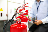 Fireman are checking and inspection red tank of fire extinguisher.Concepts of Emergency and safety