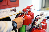 Engineer now inspection services red fire extinguishers tank
