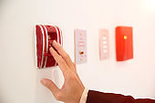 Pull in case of fire switch and fire firefighters telephone in let is mounted on the wall for fire safety