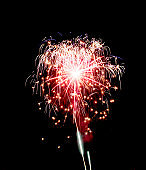 Red firework exploding in air