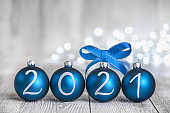 Blue Christmas balls on White Rustic Wood Board 2021 year