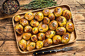Roasted potato with thyme and salt. wooden background. Top view