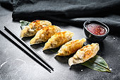 Fried dumplings. Chinese food cooking.  Black background. Top view