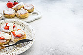Cottage cheese pancakes, syrniki, curd fritters with strawberry. Gray background. Top view. Copy space