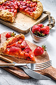 Baked galette with strawberry and rhubarb. Homemade pie, tarte.  Gray background. Top view