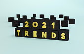 Gold 2021 Trends text on black marble cubes.