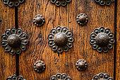 Old brown  weathered wood door background. Barcelona, Spain. Catalonia