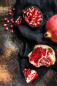 Red ripe pomegranate. Organic fruit. Black background. Top view.