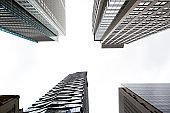 Low angle view of modern office buildings, skyscrapers, white background with copy space