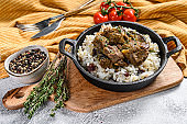 Rice with Stewed Lamb meat.  White background. Top view